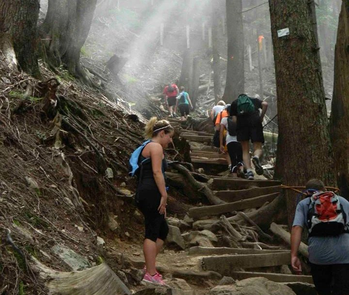 Hiking the Grouse Grind in North Vancouver, BC. The Grouse Grind is very steep so it is a popular workout hike.