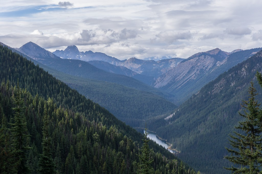 The view from the Frosty Mountain trail. Hike to the gorgeous Frosty Mountain larches in British Columbia, Canada. Go hiking in the fall to the see the larch trees change colour in Manning Park, BC, Canada.