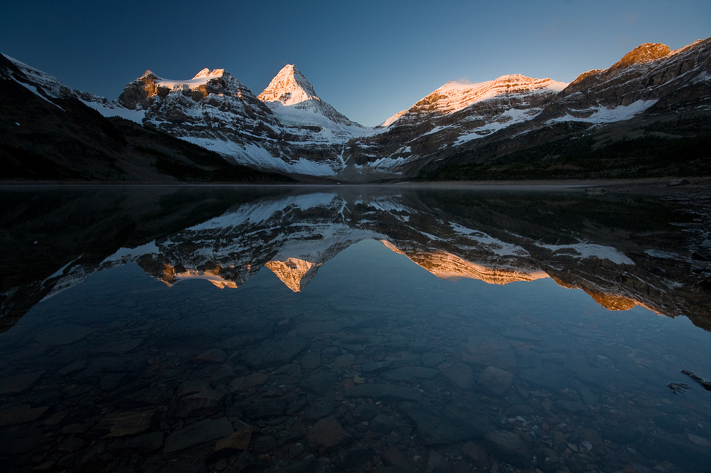 Magog Lake in Mount Assiniboine Provincial Park. Find out how to reserve campsites on this trail: BC Backpacking Reservation dates you need to know