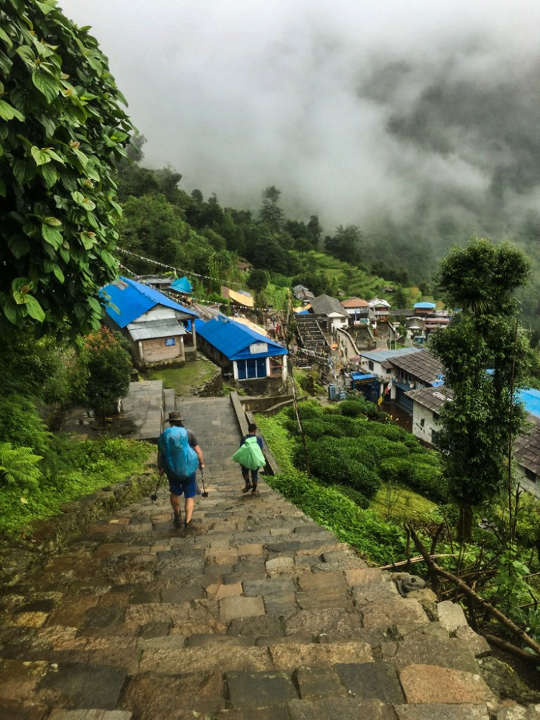 Trekking through the Gurung village of Chomrong on the Annapurna Base Camp Trek. What to pack for the Annapurna Base Camp Trek in Nepal.