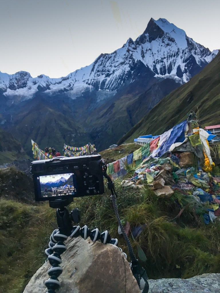 A camera on a tripod at Annapurna Base Camp. What to pack for the Annapurna Base Camp Trek in Nepal.