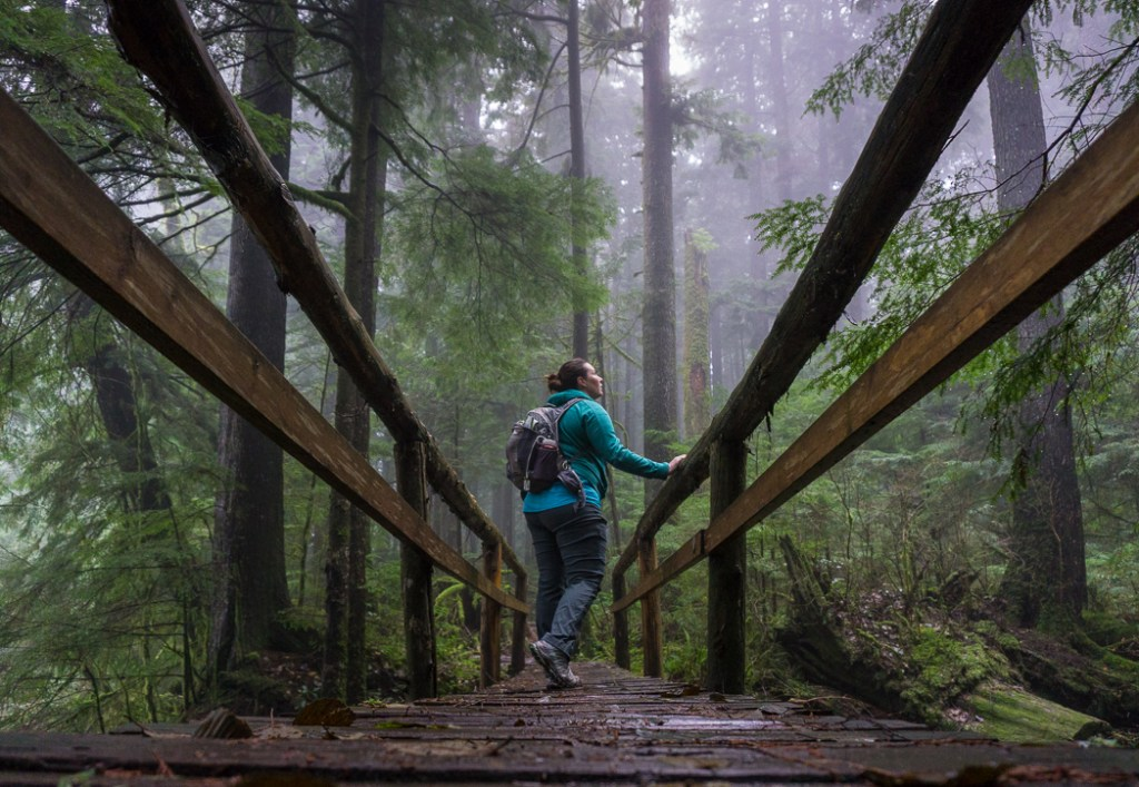 A hiker in the fog. Don't like crowds? Here are 15 ways to avoid crowded hiking trails.