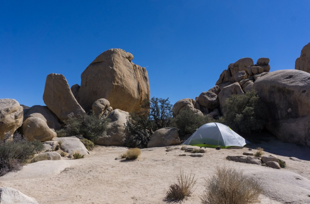 A campsite at Hidden Valley campground in Joshua Tree National Park one of 15 awesome things to do in Joshua Tree. Add camping to your Joshua Tree bucketlist.