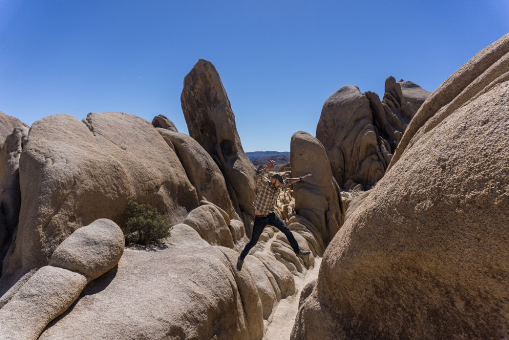 Rock scrambling near Arch Rock in Joshua Tree National Park, one of 15 awesome things to do in Joshua Tree. Add rock scrambling to your Joshua Tree bucketlist.