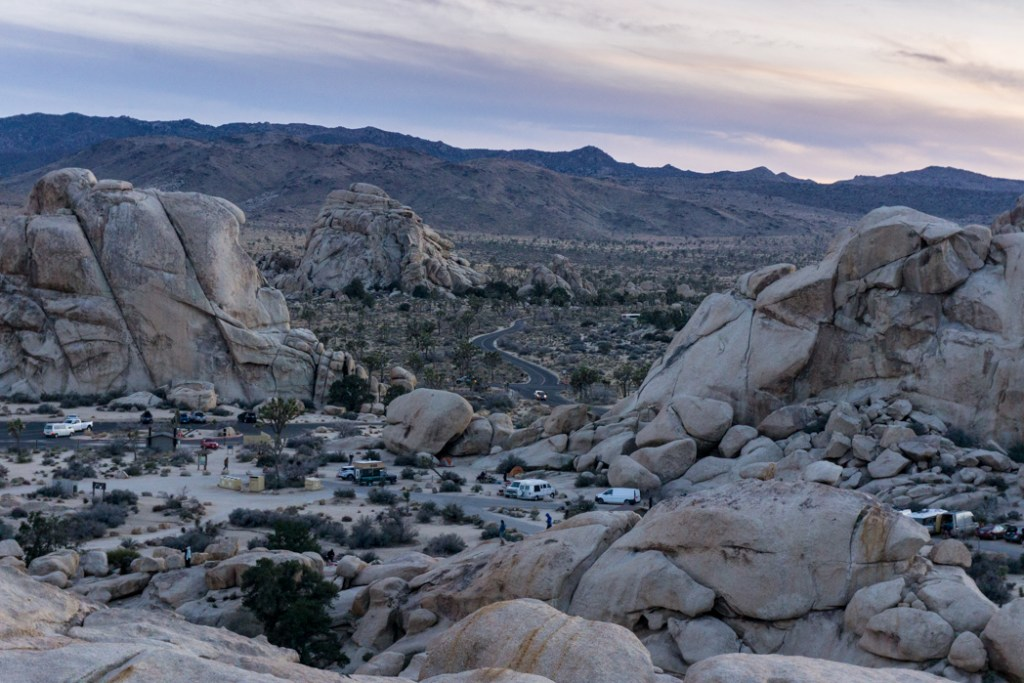 The view from above the Hidden Valley campground in Joshua Tree National Park, one of 15 awesome things to do in Joshua Tree. Add people watching to your Joshua Tree bucketlist.