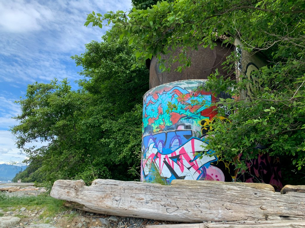 A graffiti-covered WWII defences at Tower Beach in Vancouver