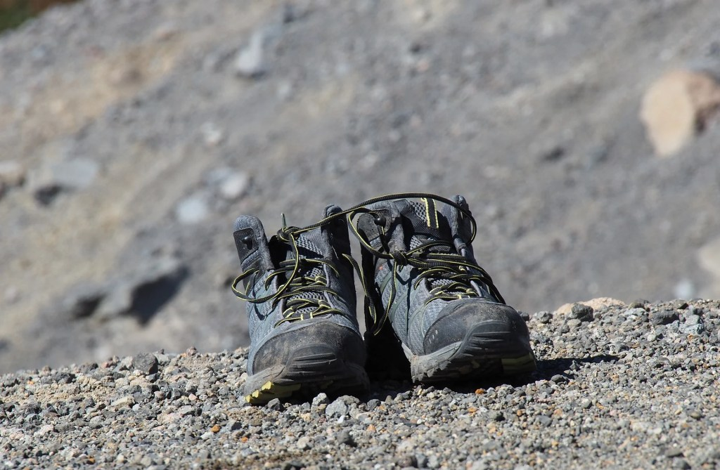 Hiking boots airing out along the trail. Find out how to prevent blisters when hiking, and how to treat blisters on the trail.