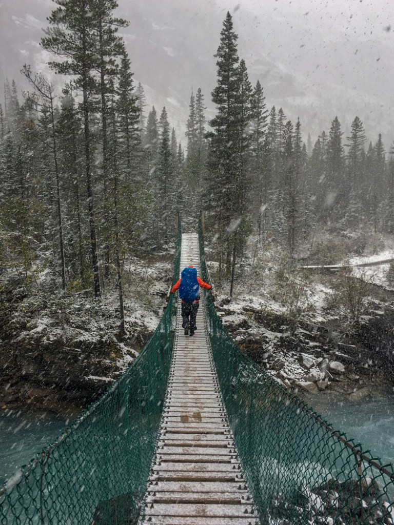 Crossing the suspension bridge near Whitehorn campground on the Berg Lake Trail. The Ultimate Guide to Hiking the Berg Lake Trail in Mount Robson Provincial Park in the Canadian Rockies
