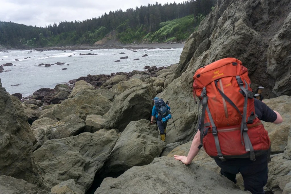 Scrambling around boulders at Scott's Bluff in Olympic National Park