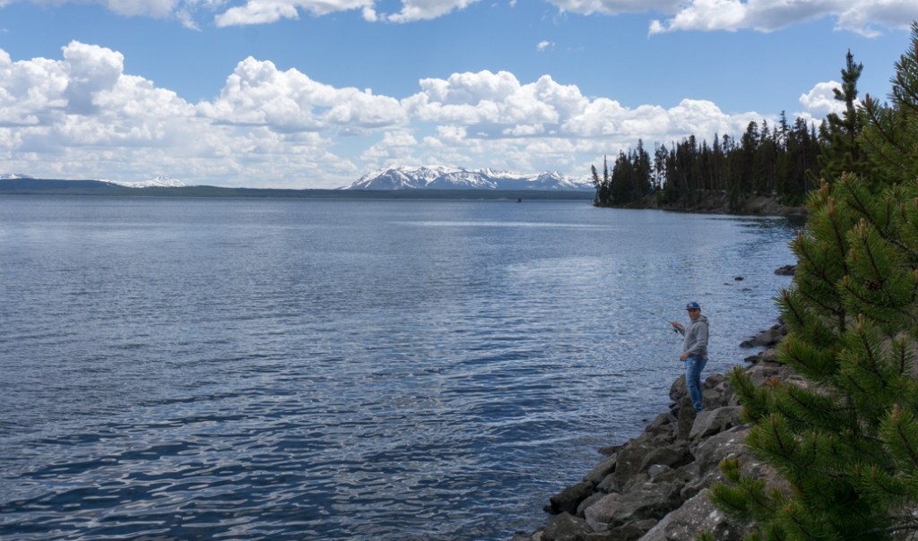 A man fishing on Yellowstone Lake