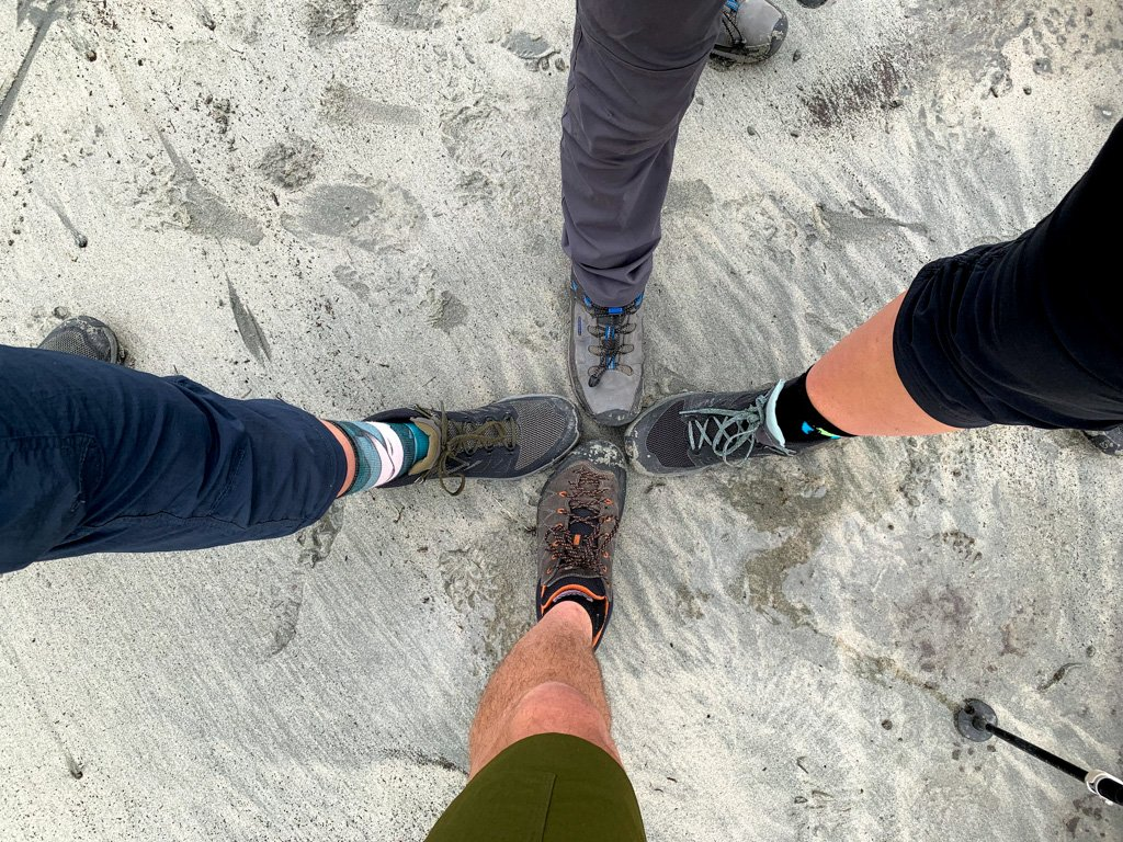 Hikers feet on the beach at Pachena Bay