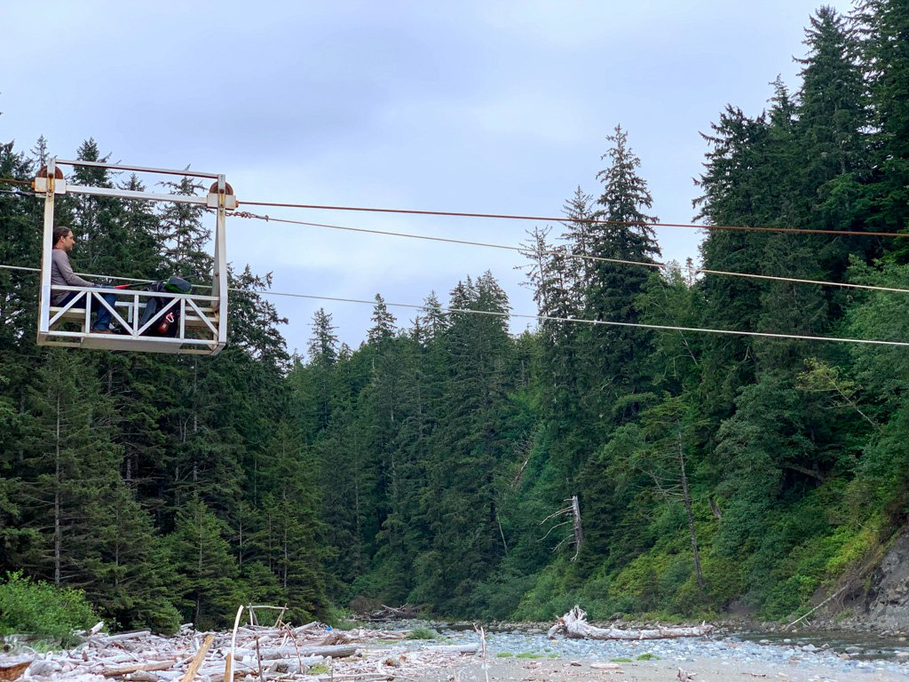 A hiker rides the Carmanah cable car on the West Coast Trail
