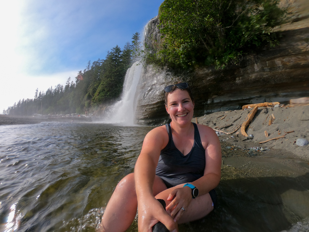 A hiker takes a selfie while swimming at Tsusiat Falls