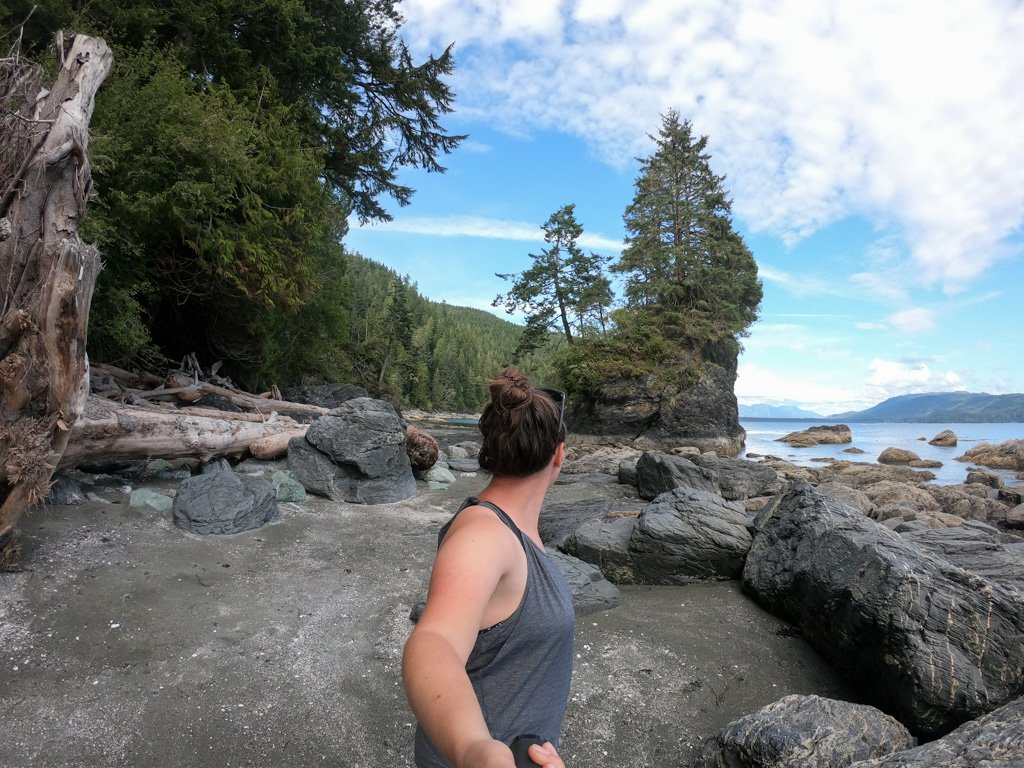 Hikers fA hiked takes a selfie near Thrasher Cove on the West Coast Trail in Canada. Get your complete West Coast Trail guide.