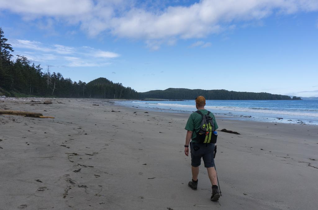 A hiker walks on Bowen Beach, Cape Scott Provincial Park