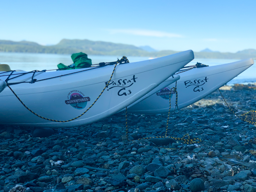 Close up of kayaks with At the Water's Edge Adventures logo