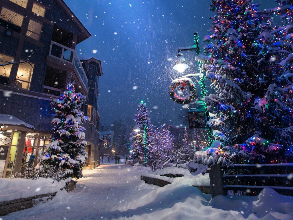 Snowy Whistler Village in the winter at night