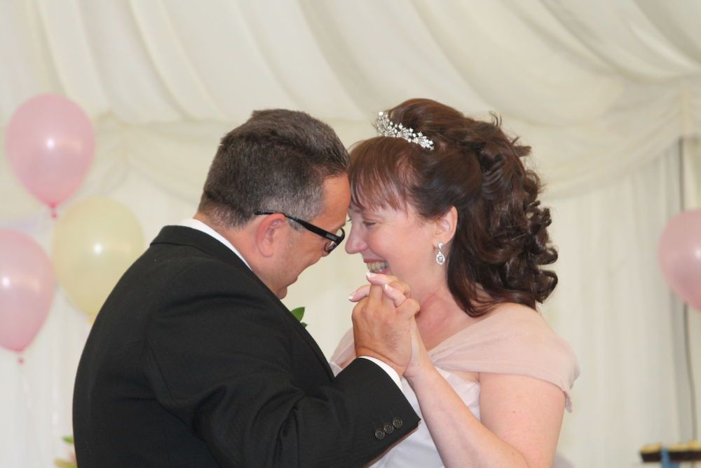 Julia and her husband at their wedding