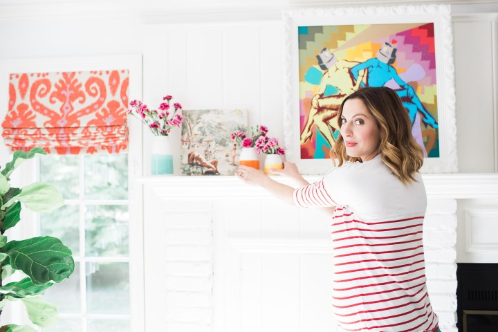 Eva Amurri Martino of lifestyle blog Happily Eva After styling the multicolored mantlepiece in her family room