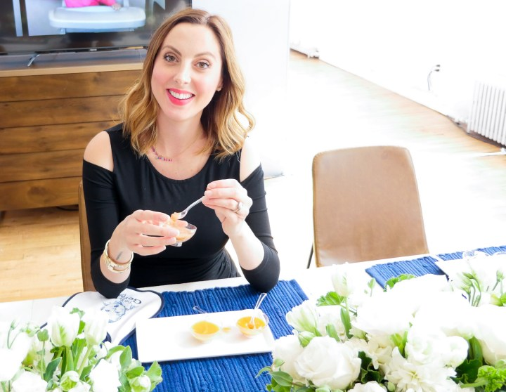 Eva Amurri Martino of lifestyle and motherhood blog Happily Eva After taste-testing new flavors at the Gerber Babies event in NYC
