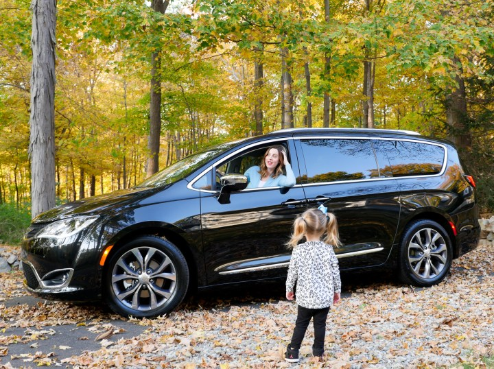 Eva Amurri Martino of lifestyle and motherhood blog Happily Eva After drives her black Chrysler pacifica on the road in Connecticut while two year old daughter Marlowe looks on