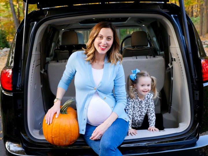 Eva Amurri Martino and Marlowe Martino pictured sitting in the trunk of the chrysler pacifica