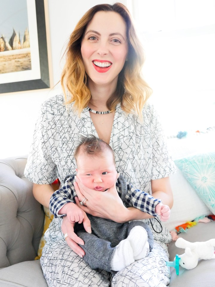 Eva amurri Martino of lifestyle and motherhood blog Happily Eva After, holding newborn son Major James at his Sip And See at home in Connecticut