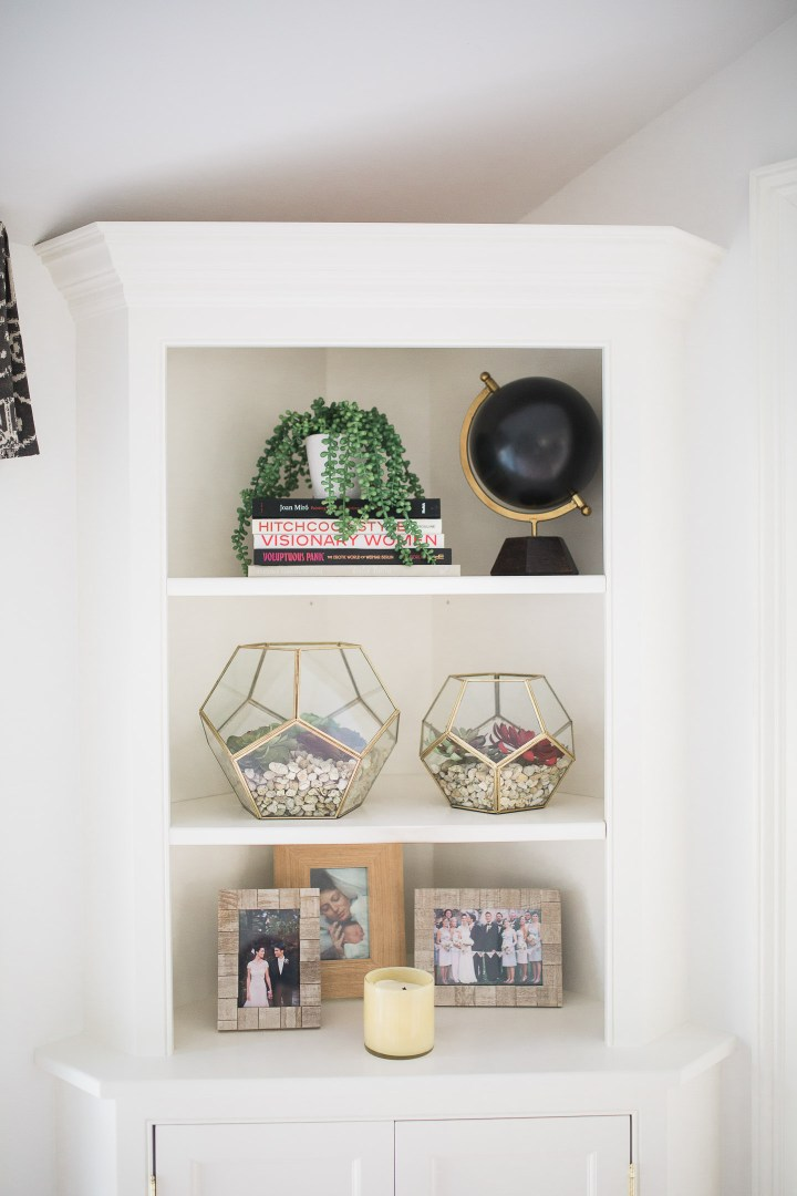 A close up of the shelves in Eva Amurri Martino's black, white, and linen Master Bedroom at her home in Connecticut