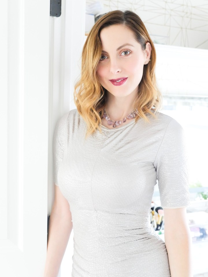 Eva Amurri Martino wears a silver bodycon dress and a vintage necklace with purple stones with a dark purple lipstick