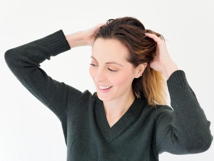 Eva Amurri Martino works volumizing mousse through her damp hair