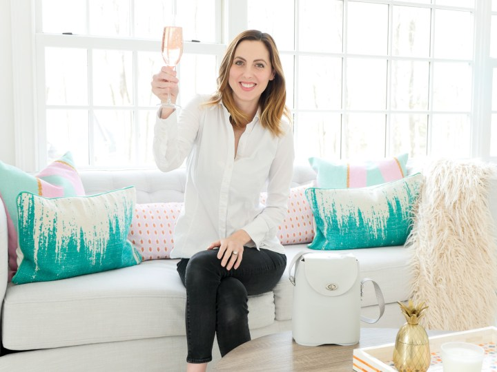 Eva Amurri Martino of lifestyle and motherhood blog Happily Eva After pictured in her studio with a glass of sparkling rose