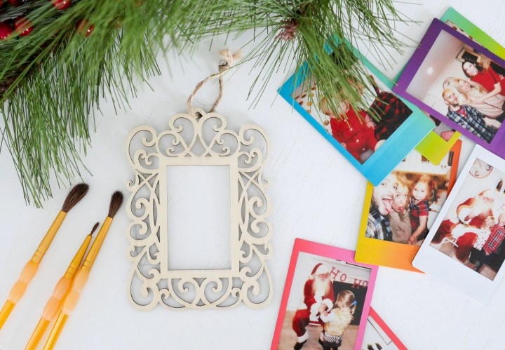 eva amurri martino uses plain wooden frames and craft pain to create holiday photo ornaments using - Mini Picture Frame Ornaments