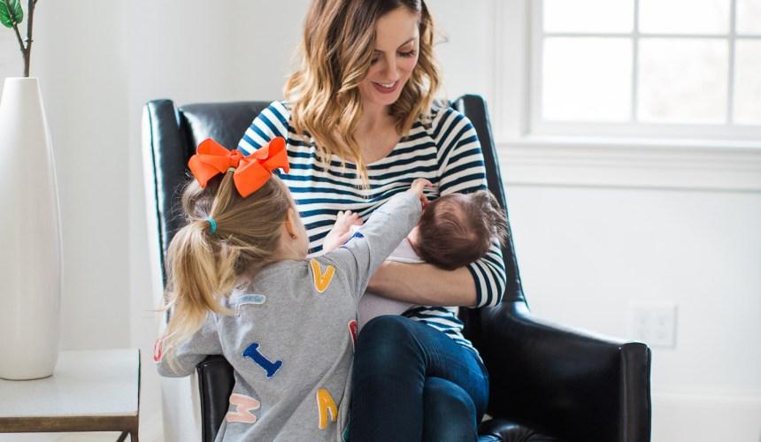 Eva Amurri Martino breastfeeds her newborn son, major, while daughter Marlowe looks on