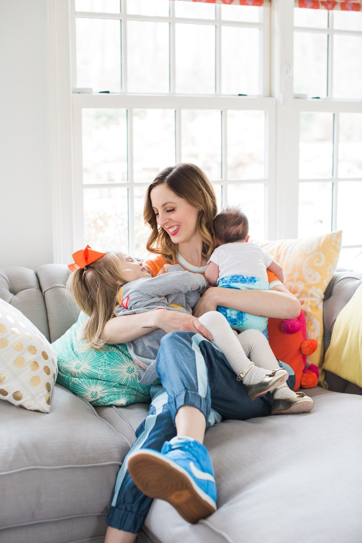 Eva Amurri Martino of lifestyle and motherhood blog Happily Eva After, embraces her two year old daughter Marlowe and her newborn son Major in their family home in connecticut