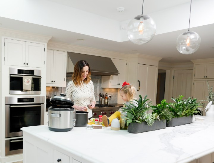 Eva Amurri Martino makes her crockpot chicken noodle soup with her daughter Marlowe at home in Connecticut
