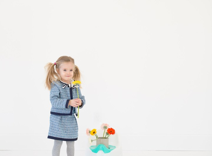 Marlowe Martino wears a tweed suit and pink kitty shoes and stands by her potty