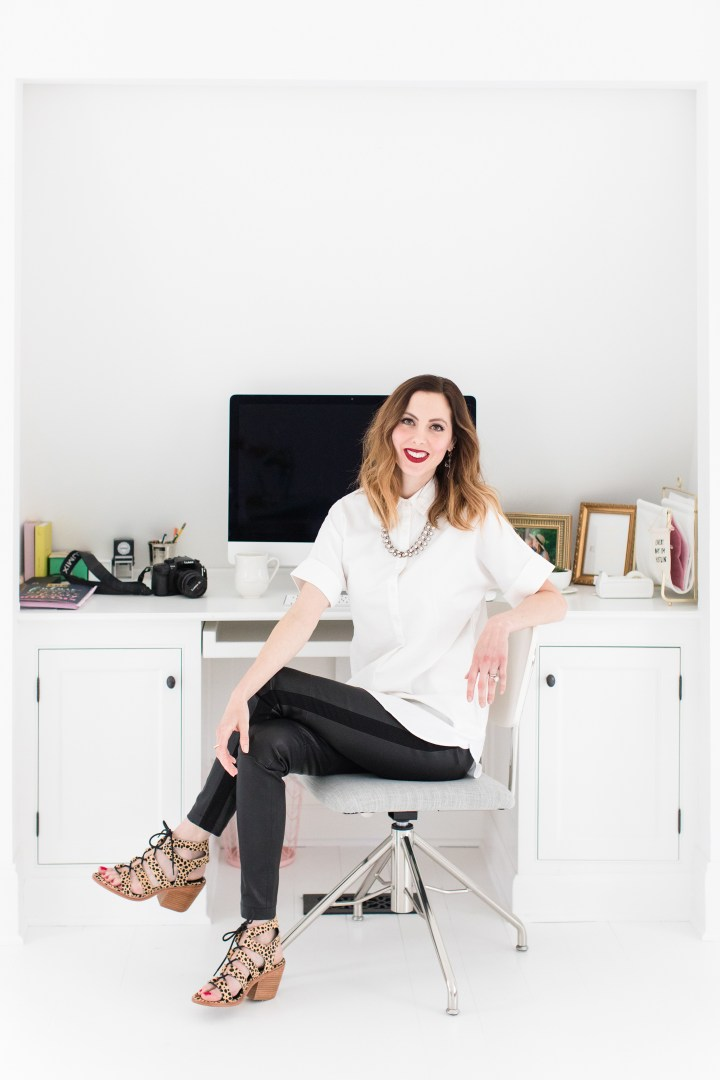 Eva Amurri Martino sits at her desk in the Happily Eva After Studio