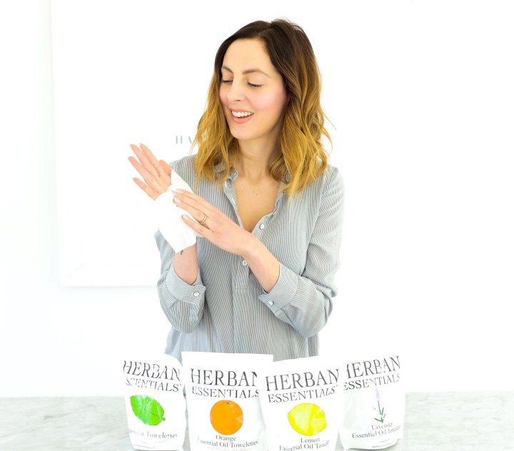 Eva Amurri Martino wipes down her hands with an essential oil towelette
