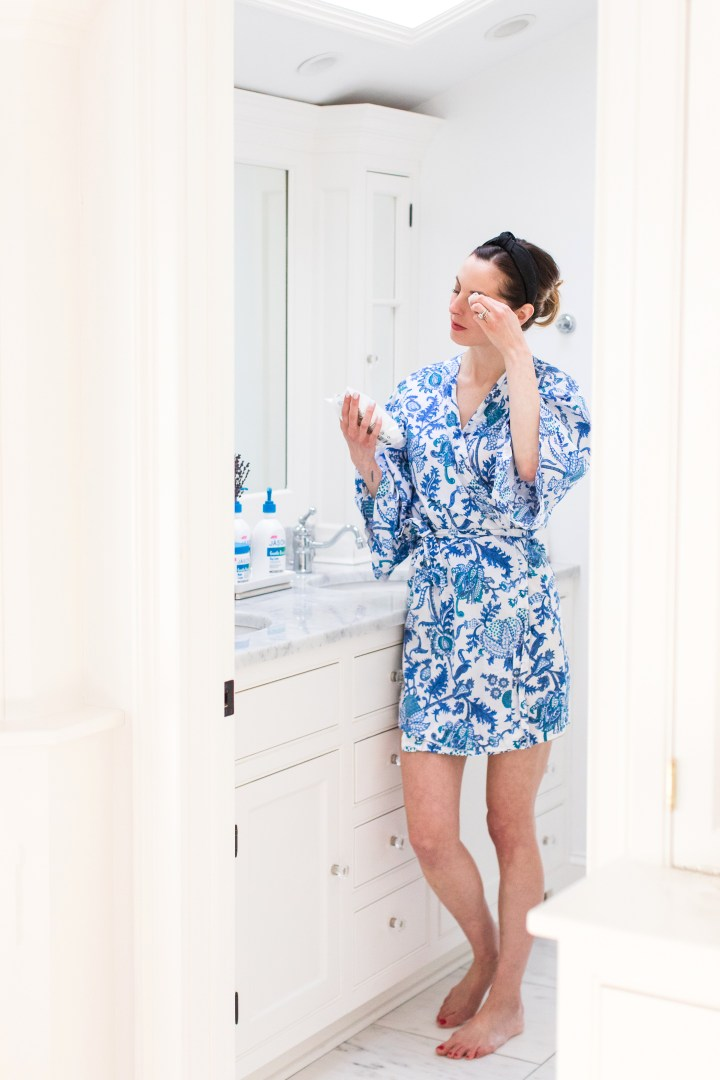 Eva Amurri Martino stands in her Master Bathroom using a Gentle Basics cleansing wipe to remove her makeup before bed