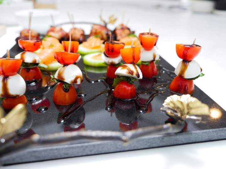 A close up of Caprese Salad bites, drizzled with Balsamic Vinegar glaze