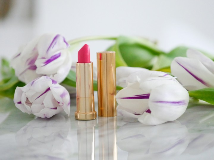 Eva Amurri Martino selects a bright pink liptick in a gold art deco case as one of her monthly obsessions