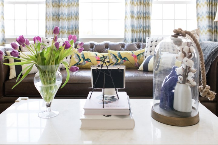 The coffee table and leather couch in the formal living room of Eva Amurri Martino's connecticut home