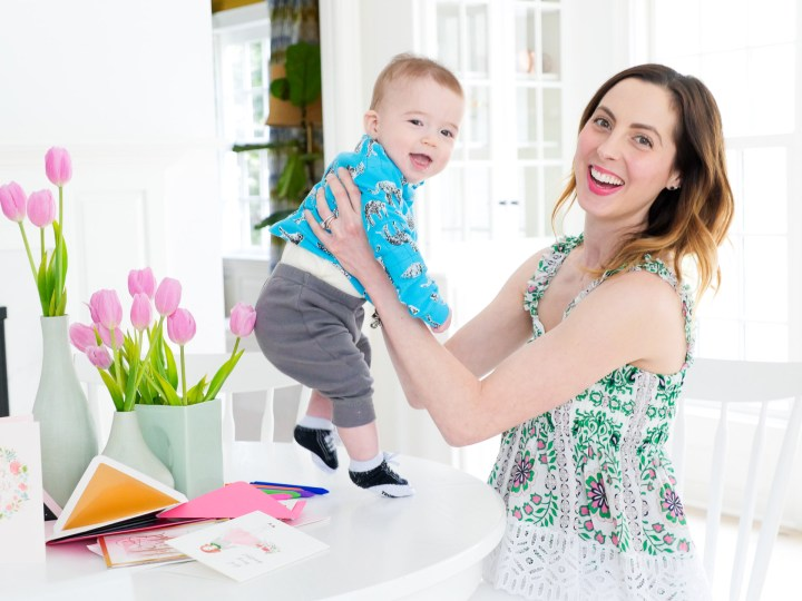 Eva Amurri Martino lifts her six month old son, Major Martino, in to the air