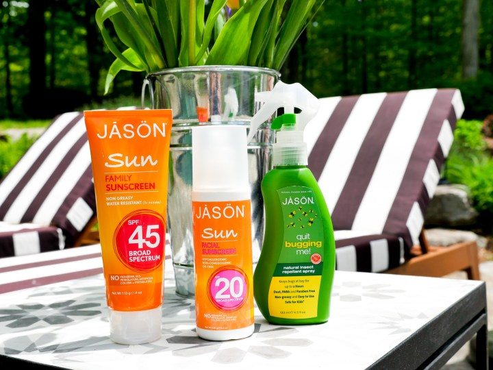 JASON sunblock and bug spray are displayed on the mosaic table beside Eva Amurri Martino's striped pool chairs