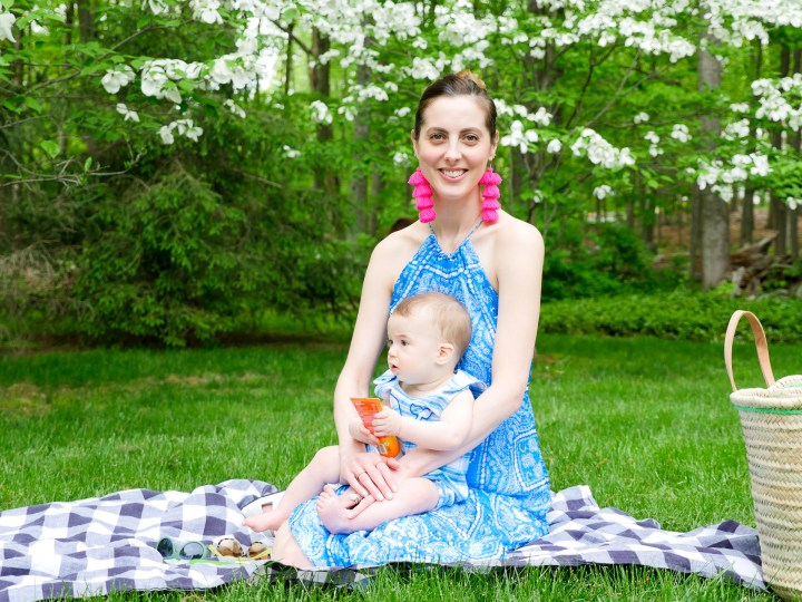 Eva Amurri Martino sits on a picnic blanket with her seven month old son, Major
