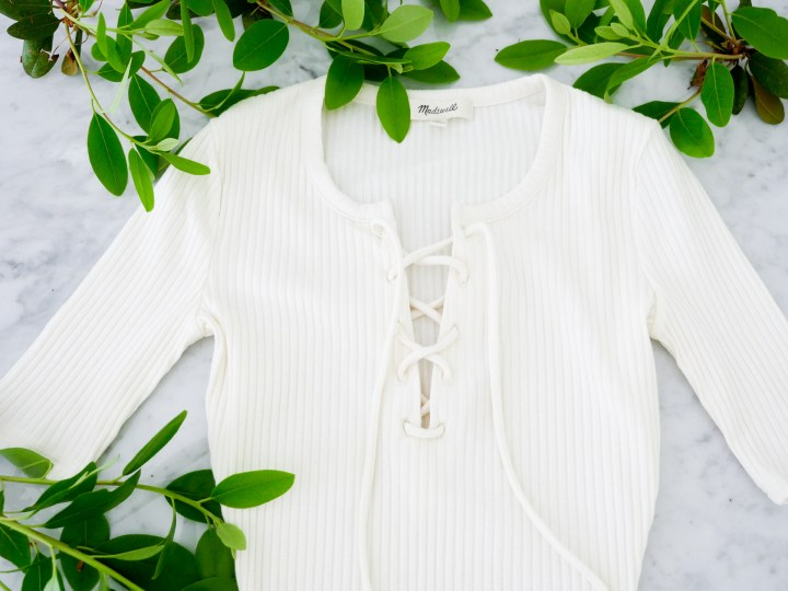 Eva Amurri Martino features a Madewell lace up off-white bodysuit as part of her monthly obsessions roundup