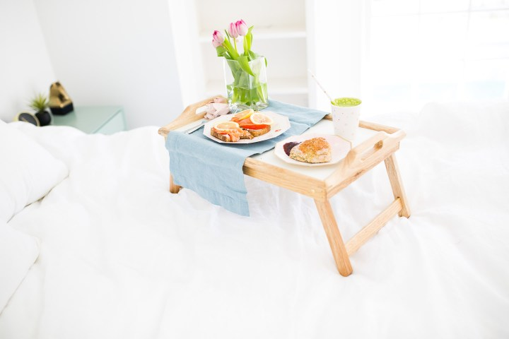 A breakfast tray is decked out with a yummy and healthy Mother's Day breakfast