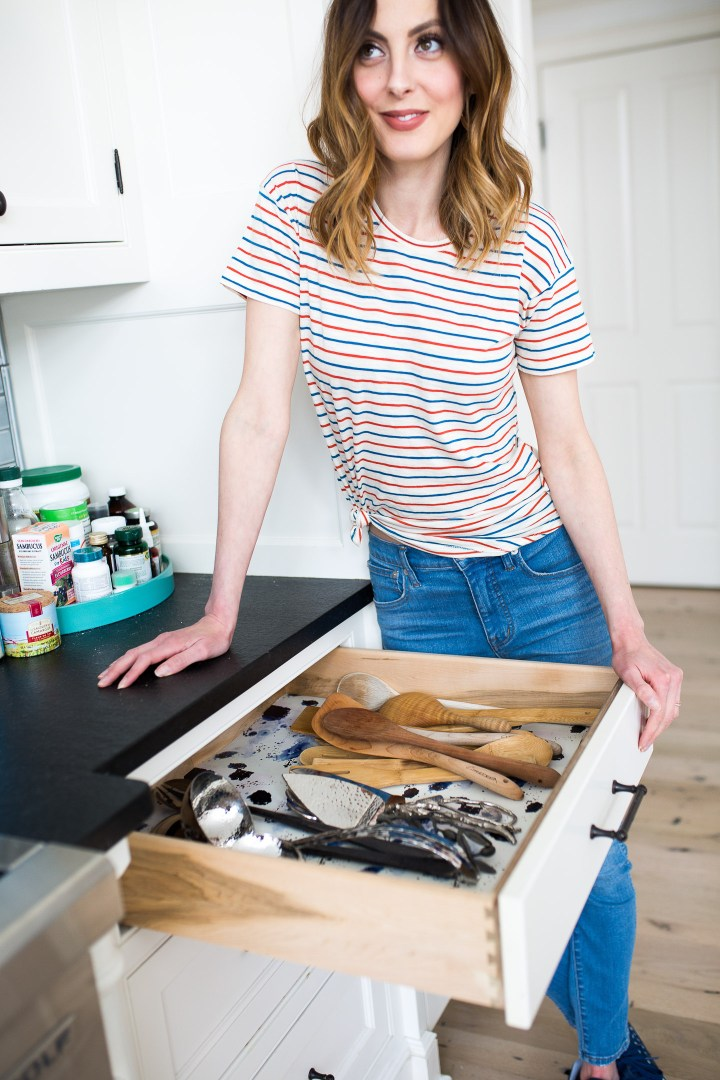 Eva Amurri Martino gives her serving drawer a bit of life with leftover wallpaper