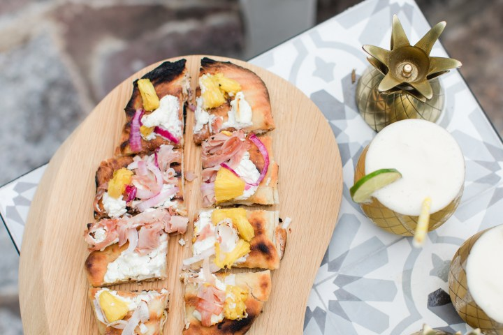 Eva Amurri Martino serves a grilled Hawaiian pizza at her Pineapple themed Happy Hour at her Connecticut home