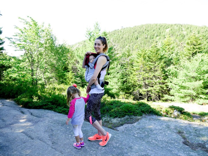 Eva Amurri Martino holds Major Martino in a baby carrier, and holds Marlowe Martino's hand on a hike in Acadia National Park